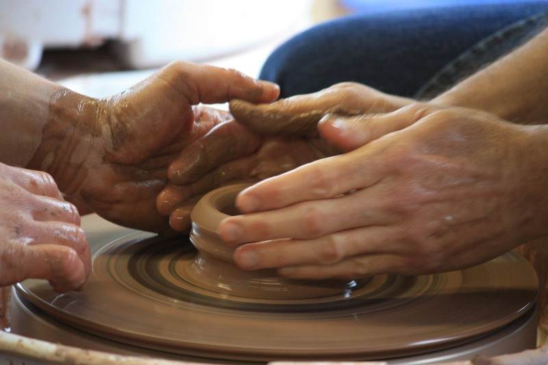Throwing pottery on the wheel